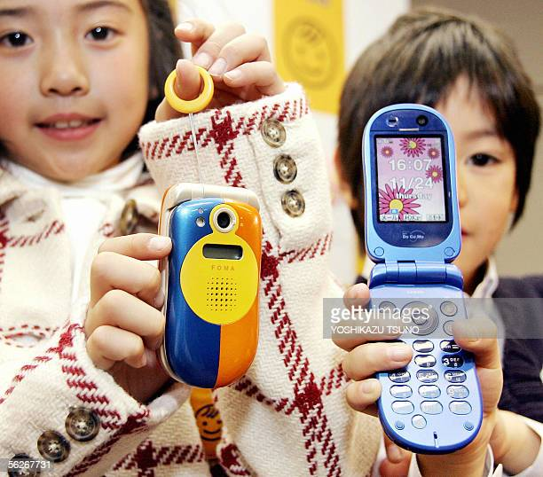 Japan's electronics giant NTT DoCoMo unveils the new childfriendly 3G mobile handset 'FOMA SA 800i with GPS device to keep children safe during a...