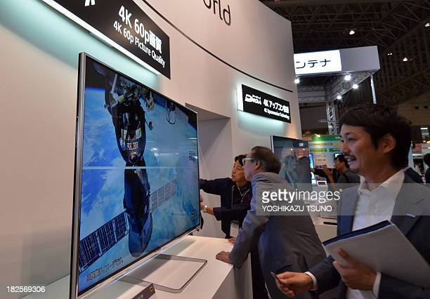 Japan's electronics giant Panasonic displays the high resolution LCD 4K television set Viera at the Ceatec electronics trade show in Chiba Tokyo on...