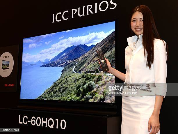 Japan's electronics giant Sharp displays their new premium LCD television set ICC Purios with a 60 inch 4K LCD panel and 3840 x 2160pixel resolution...