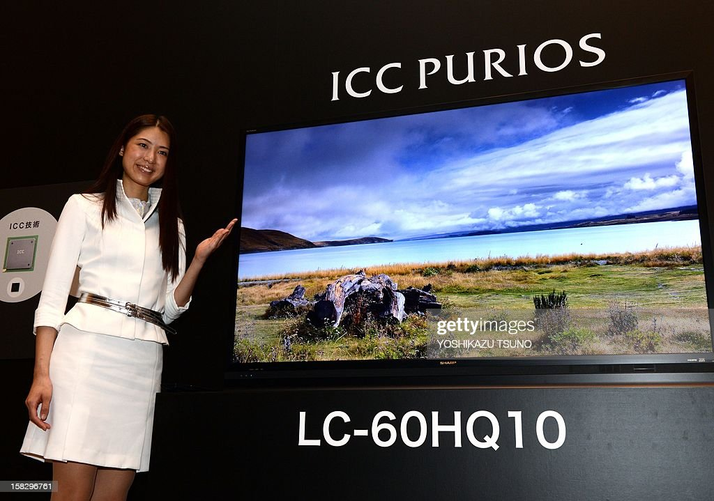 Japan's electronics giant Sharp displays their new premium LCD television set 'ICC Purios' with a 60 inch 4K LCD panel and 3,840 x 2,160-pixel resolution priced at 2.625 million yen (32,000 USD) in Tokyo on December 13, 2012. Sharp will launch the new premium brand 'ICC Purios' for the company's new line up of television sets. AFP PHOTO / Yoshikazu TSUNO