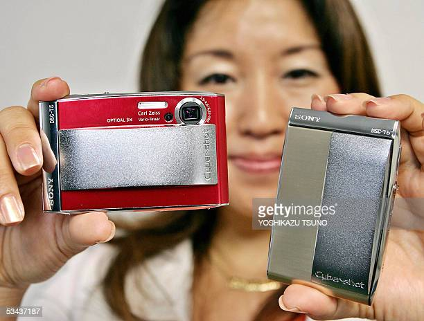 "Japan's electronics giant Sony employee Yuka Komatsu displays the new stylish digital camera ""Cybershot DSC-T5"", equipped with a 5.3 mega-pixel CCD..."