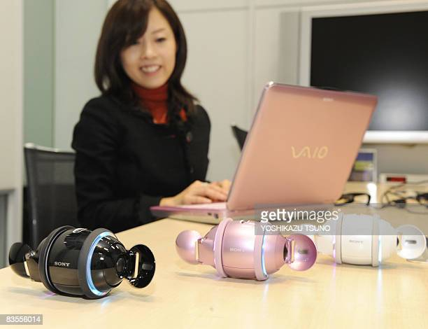 Japan's electronics giant Sony employee Yuki Shima displays the new model of the company's entertainment digital music player 'Rolly' equipped with a...
