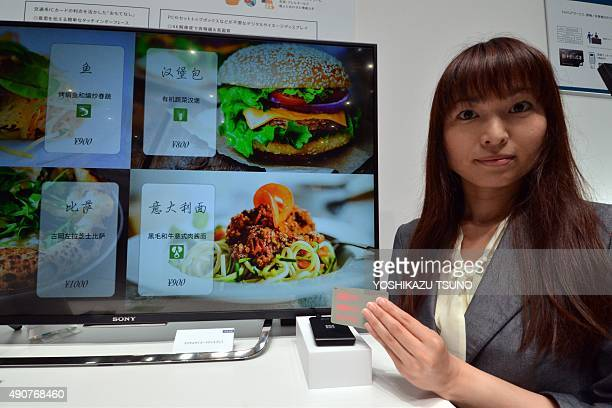 Japan's electronics giant Sony unveils a new smart card for a new service which can change the language of menus or other information for foreign...
