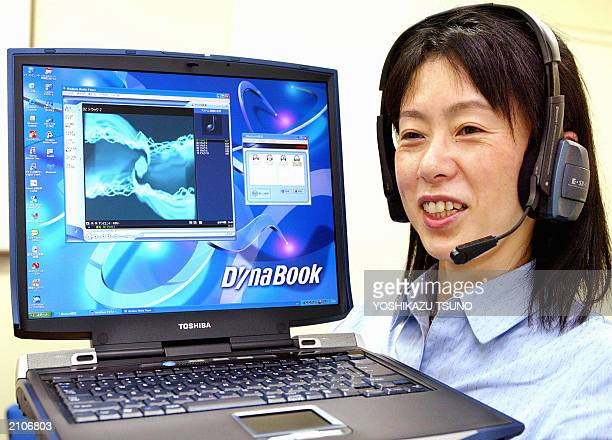 Japan's electronics giant Toshiba employee Junko Furuta displays the company's latest notebook computer Dynabook G8 equipped with 2GHzMobile Pentium...