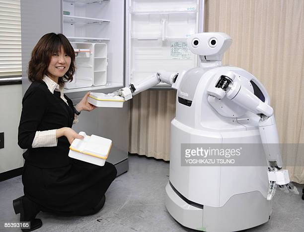 Japan's electronics giant Toshiba introduces the prototype housekeeping robot 'ApriAttenda' which is able to open the door of a refrigerator and...