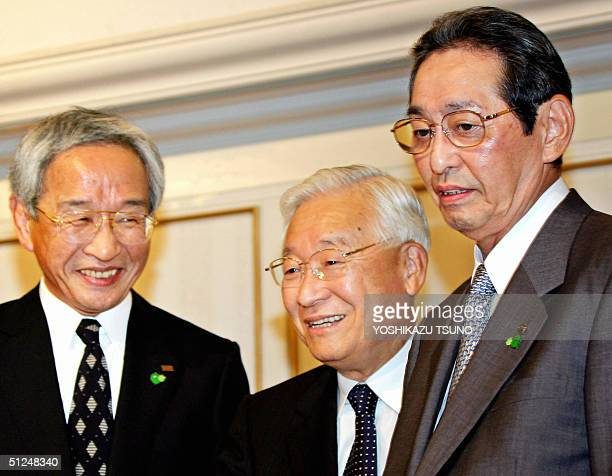 Japan's electronics giants presidents Tadashi Okamura of Toshiba, Etsuhiko Syoyama of Hitachi and Kunio Nakamura of Matsushita share smiles as they...