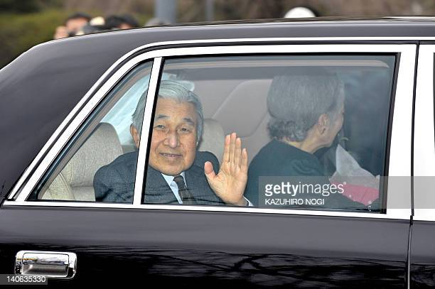 Japan's Emperor Akihito accompanied by Empress Michiko waves to wellwishers upon his arrival at the Imperial Palace in Tokyo on March 4 2012 after...