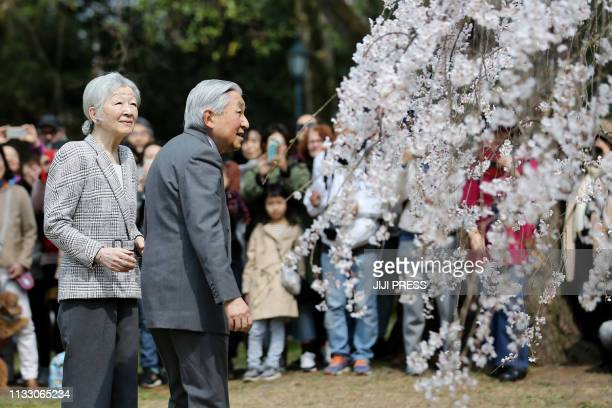 Japan's Emperor Akihito ad Empress Michiko admire cherry blossoms at Kyoto Gyoen National Garden in Kyoto on March 27 2019 Akihito will abdicate from...