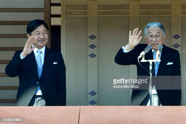 Japan's Emperor Akihito and Crown Prince Naruhito wave to wellwishers at the Imperial Palace in Tokyo on January 2 2019 during New Year's greetings...