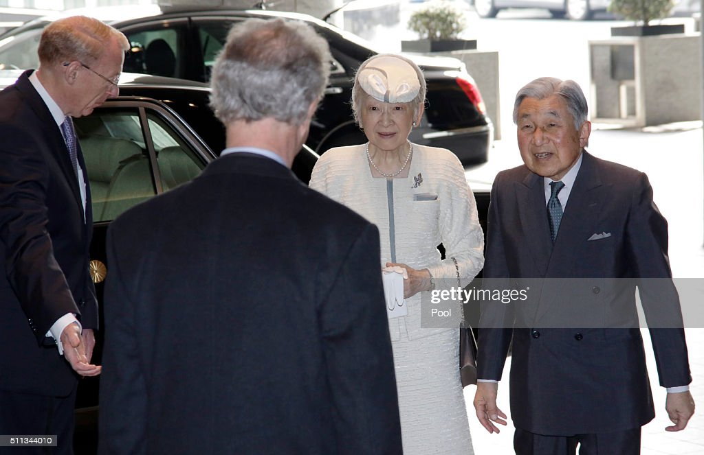 Japan's Emperor Akihito (R) and Empress Michiko (2nd R) are greeted by Swedish Ambassador Magnus Robach (2nd L) in Tokyo on February 20, 2016.