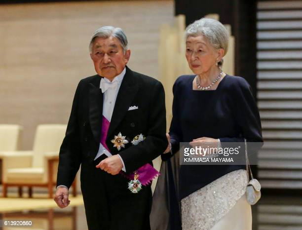 Japan's Emperor Akihito and Empress Michiko arrive at an entrance hall at the Imperial Palace to welcome Belgium's King Philippe and Queen Mathilde...