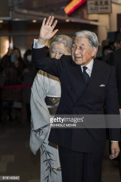 Japan's Emperor Akihito and Empress Michiko arrive at Kabukiza theatre to watch a traditional Japanese performance in Tokyo on February 14 2018 / AFP...
