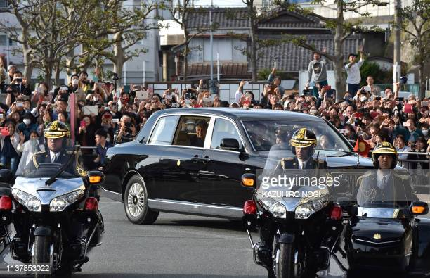 Japan's Emperor Akihito and Empress Michiko commute in a vehicle before leaving Ujiyamada Station after visiting Ise Jingu shrine in Ise in the...