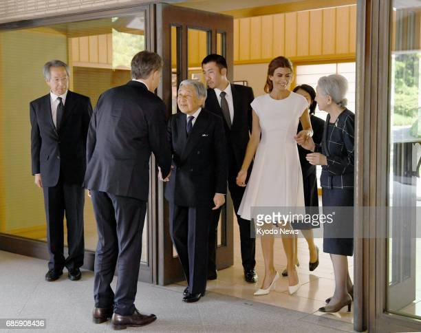 Japan's Emperor Akihito and Empress Michiko see Argentine President Mauricio Macri and his wife Juliana Awada off at the Imperial Palace in Tokyo on...