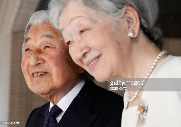 Japan's Emperor Akihito and Empress Michiko see off US President Donald Trump and his wife Melania after their meeting at the Imperial Palace in...