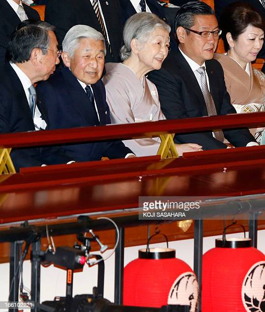Japan's Emperor Akihito and Empress Michiko smile as they attend a performance at the newlyrefurbished Kabukiza in Tokyo on April 9 2013 The curtain...