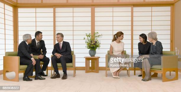 Japan's Emperor Akihito and Empress Michiko speak with Argentine President Mauricio Macri and his wife Juliana Awada at the Imperial Palace in Tokyo...