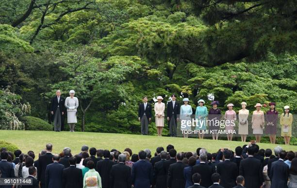 Japan's Emperor Akihito and Empress Michiko stand on a hill with members of the royal family Crown Prince Naruhito Crown Princess Masako Prince...