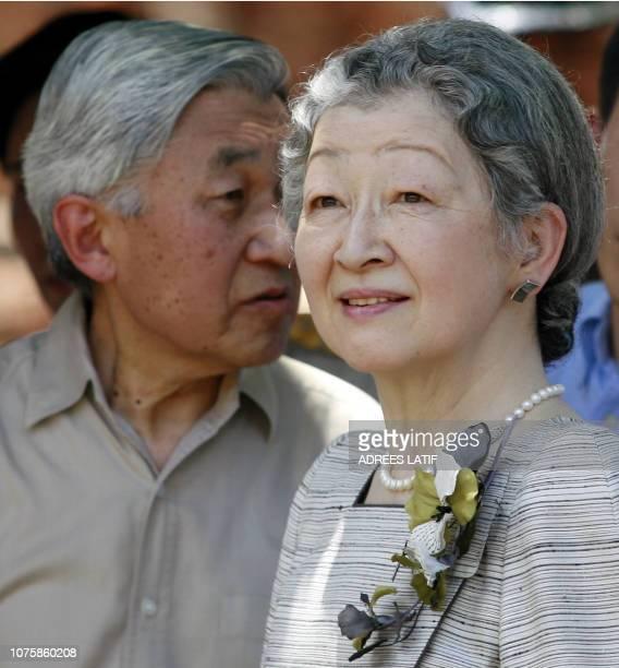 Japan's Emperor Akihito and Empress Michiko visit Wat Mahathat in the ancient Thai capital of Ayutthaya 80 km north of Bangkok 14 June 2006 The...