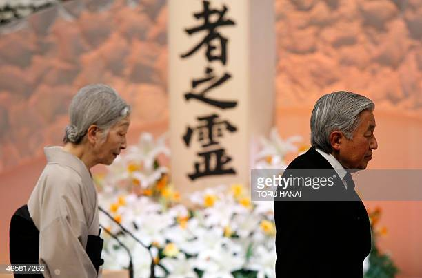 Japan's Emperor Akihito and Empress Michiko walk in front of the altar for the victims of the March 11 2011 earthquake and tsunami at the national...