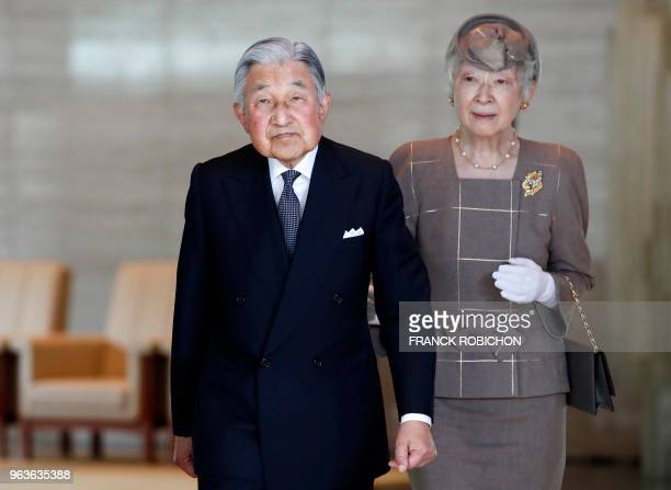 Japan's Emperor Akihito and Empress Michiko walk on their way to welcome Vietnam's President Tran Dai Quang and his wife Nguyen Thi Hien at the...