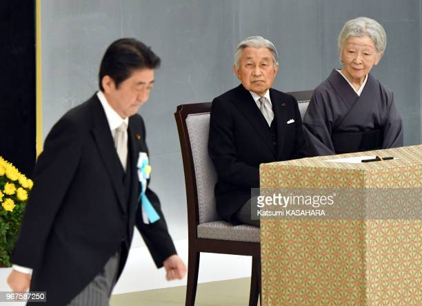 Japan's emperor Akihito and empress Michiko watch the speech of Prime Minister Shinzo Abe left during the 72th anniversary ceremony of the end of...