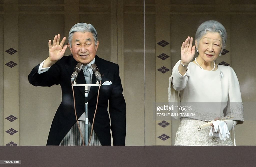 Japan's Emperor Akihito (L) and Empress Michiko (R) wave from the balcony of the Imperial Palace during their annual new year greeting in Tokyo on January 2, 2015. Tens of thousands came out to hear the emperor's annual speech and see the royal family at the Imperial Palace.