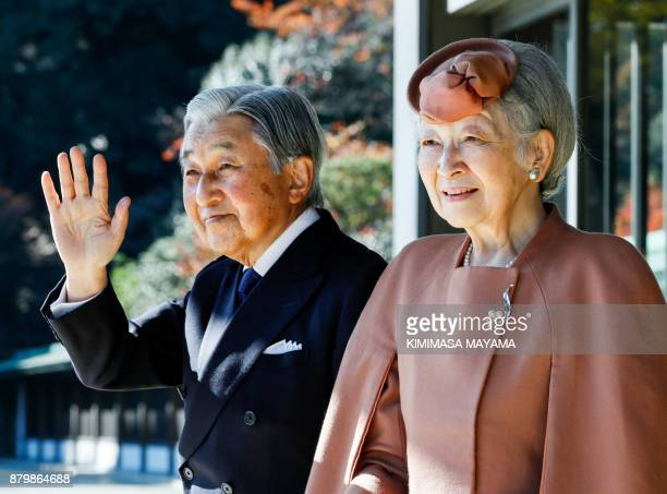 Japan's Emperor Akihito and Empress Michiko wave to Luxembourg's Grand Duke Henri after their meeting and welcoming ceremony for the grand duke at...