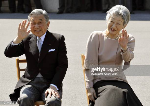 Japan's Emperor Akihito and Empress Michiko wave to wellwishers as they listen to the Imperial Guard music band's performance celebrating their 50th...