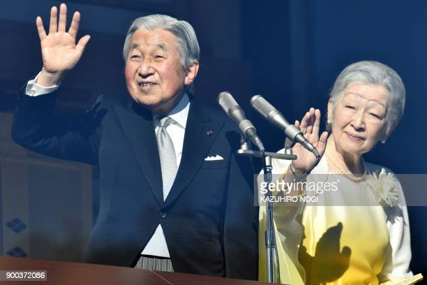 Japan's Emperor Akihito and Empress Michiko wave to wellwishers from the balcony of the Imperial Palace in Tokyo on January 2 2018