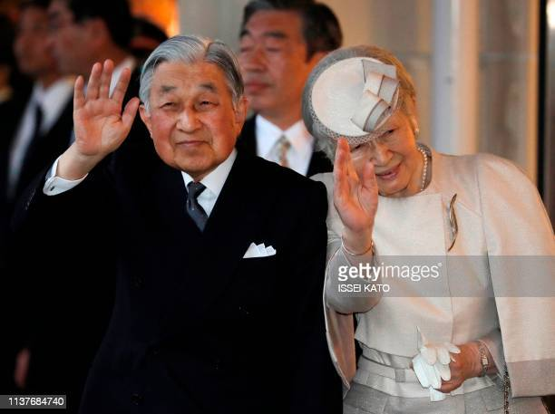 Japan's Emperor Akihito and Empress Michiko wave to wellwishers upon their arrive at Ujiyamada Station for a visit to Ise Jingu shrine ahead of his...