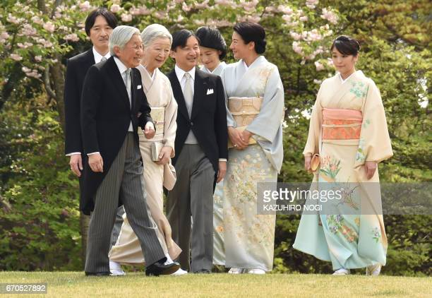 Japan's Emperor Akihito and Empress Michiko with members of the royal family walk to greet guests during the spring garden party at the Akasaka...