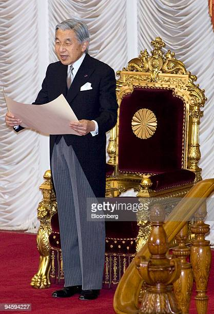 Japan's Emperor Akihito delivers a speech during the opening of an extraordinary session of the Upper House Parliament at the National Diet in Tokyo...