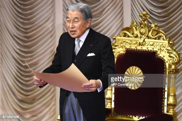 Japan's Emperor Akihito delivers his opening address for the 195th parliament session at the upper house of parliament in Tokyo on November 8 2017...