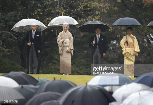 TOPSHOT Japan's Emperor Akihito Empress Michiko Crown Prince Naruhito and Crown Princess Masako attend an autumn garden party at Akasaka Palace...