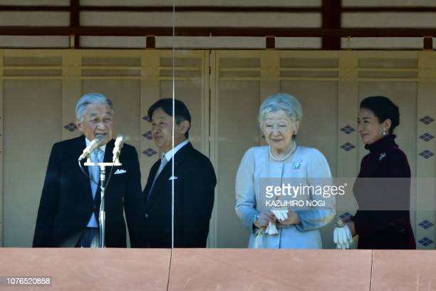 Japan's Emperor Akihito Empress Michiko Crown Prince Naruhito and Crown Princess Masako attend New Year's greetings to wellwishers at the Imperial...