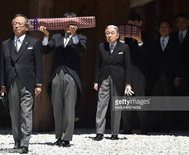 Japan's Emperor Akihito leaves the outer shrine of Ise Jingu Shrine in Ise in the central Japanese prefecture of Mie on April 18 as he takes part in...