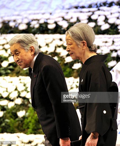 Japan's Emperor Akihito left and Empress Michiko attend a memorial service at the National Theater in Tokyo Japan on Sunday March 11 2012 Japan's...