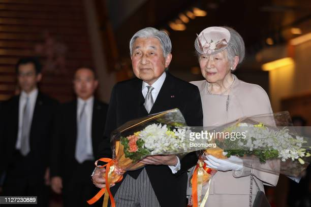Japan's Emperor Akihito left and Empress Michiko depart after attending the ceremony commemorating the 30th anniversary of the Emperor's reign at the...