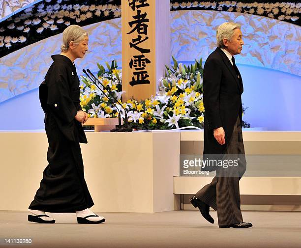 Japan's Emperor Akihito right and Empress Michiko attend a memorial service at the National Theater in Tokyo Japan on Sunday March 11 2012 Japan's...