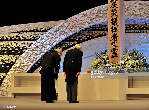 Japan's Emperor Akihito right and Empress Michiko pray during a memorial service at the National Theater in Tokyo Japan on Sunday March 11 2012...