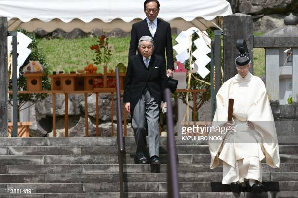 TOPSHOT Japan's Emperor Akihito visits the mausoleum of his late father Emperor Hirohito during a ceremony ahead of his abdication at the Musashino...