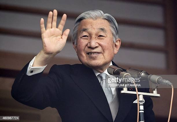 Japan's Emperor Akihito waves to wellwishers during the imperial family's new year greetings in Tokyo on January 2 2015 Tens of thousands came out to...