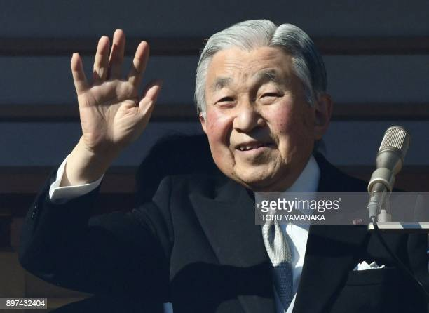 Japan's Emperor Akihito waves to wellwishers from a balcony at the Imperial Palace in Tokyo on December 23 2017 Japan's Emperor Akihito who plans to...