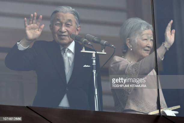 Japan's Emperor Akihito waves to wellwishers on his birthday beside Empress Michiko at the Imperial Palace on December 23 2018 Japan's Emperor...