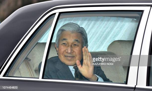 Japan's Emperor Akihito waves to wellwishers upon his arrival at the Imperial Palace in Tokyo on March 4 2012 after being discharged from University...