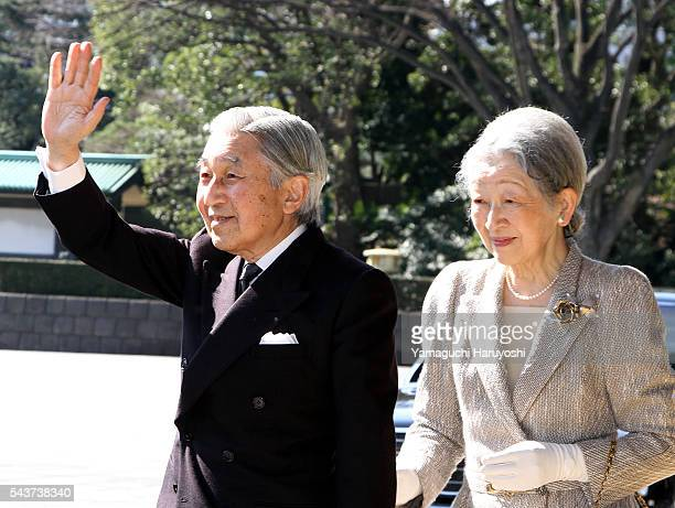 Japan's Emperor Akihitoleft and Empress Michiko wave upon their arrival at a welcoming ceremony for Kuwaiti Emir Sheikh Sabah alAhmad alSabah at the...