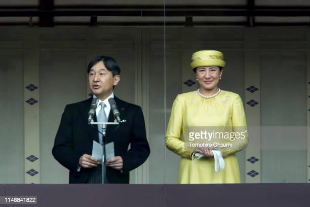 Japan's Emperor Naruhito addresses as Empress Masako looks on from the balcony of the Imperial Palace on May 04, 2019 in Tokyo, Japan. Emperor...