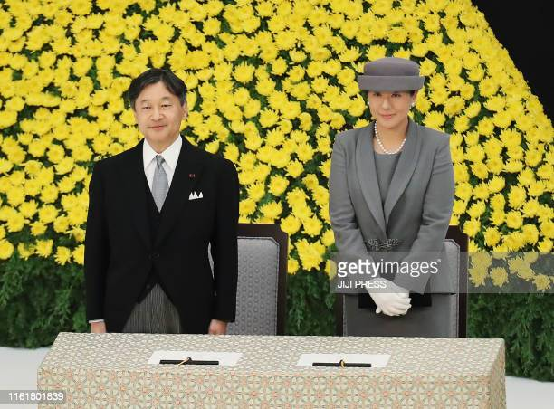 Japan's Emperor Naruhito and Empress Masako attend the annual memorial ceremony to remember those lost at war on August 15 in Tokyo as the country...