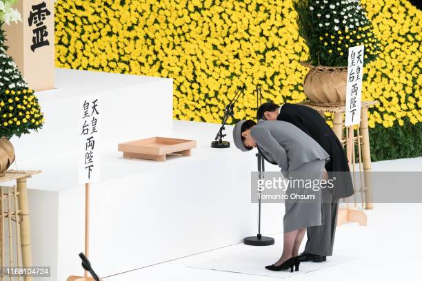 Japan's Emperor Naruhito and Empress Masako bow during a memorial service marking the 74th anniversary of Japan's surrender in World War II at the...